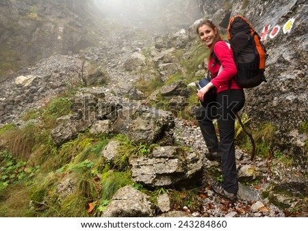 Young brunette girl trekking in Mehedinti Mountains, Romania, Europe  - stock photo
