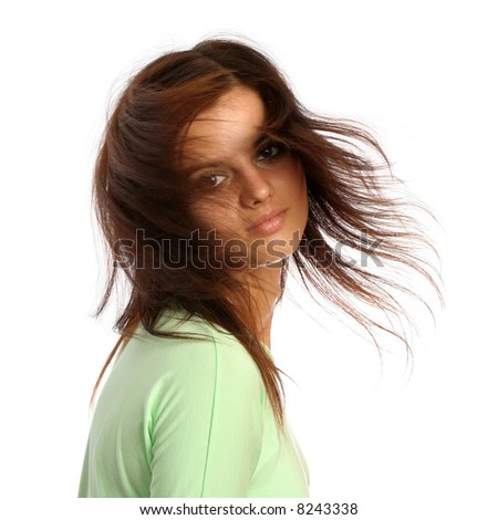 Young brunette girl with a hairdress in movement, isolated on white