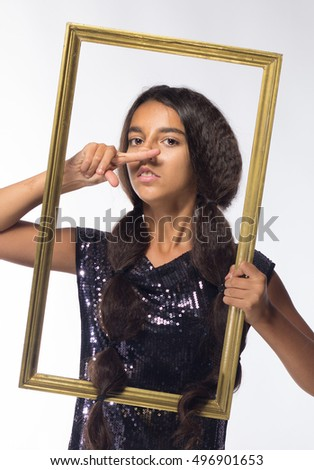 young brunette girl with long hair in black dress with a frame on a white background