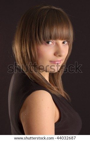 Young brunette in black dress - stock photo