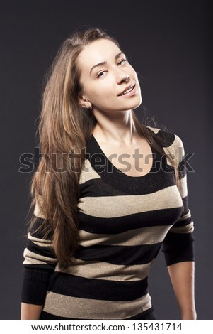 young brunette in striped sweater - stock photo