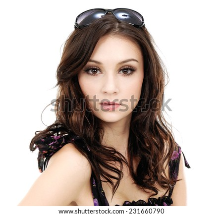 Young brunette lady in sunglasses with a beautiful hair - stock photo