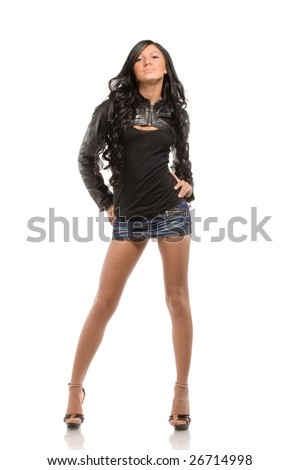 Young brunette posing in short skirt. Isolated over white background