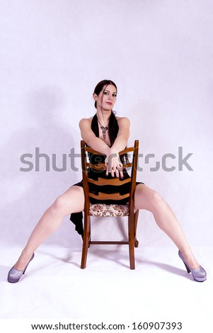 young brunette sitting on chair