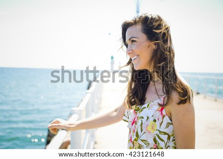 young brunette wearing summer outfit on the beach - stock photo