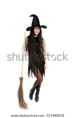 Young brunette witch with broom isolated on a white
