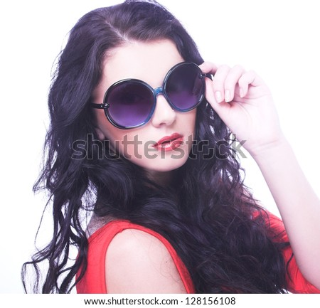 Young brunette with big sunglasses. - stock photo