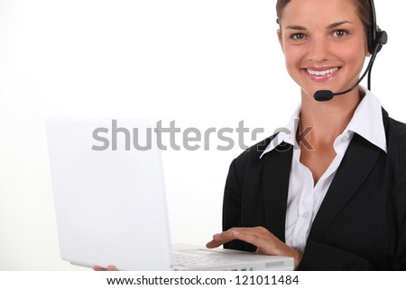 Young brunette with computer in hand - stock photo
