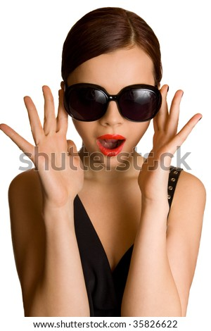 Young brunette with huge glasses shocked - stock photo