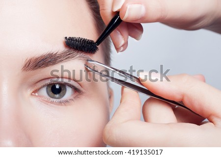 young brunette with short hair woman make-up. girl Cosmetic. Base for Perfect Make-up.Applying Make-up, correction and eyebrow styling. perfect eyebrows