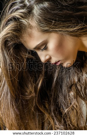 young brunette woman face and hair - stock photo