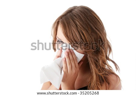 Young brunette woman having a cold close up isolated on white background - stock photo