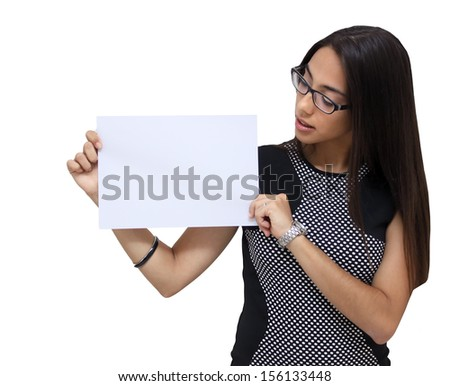Young Brunette woman holding and staring at card - stock photo