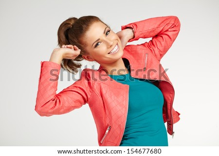 young brunette woman in autumn color isolated on grey background - stock photo