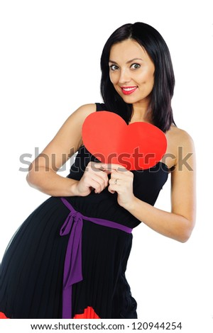 Young brunette woman in black sweater holding red paper heart isolated on white - stock photo