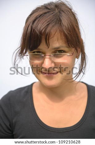 Young brunette woman in black t-shirt wearing glasses - stock photo
