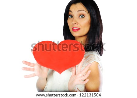 Young brunette woman in elegant dress holding red heart. Isolated on white - stock photo