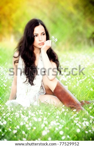 young brunette woman in field, summer day, sunset