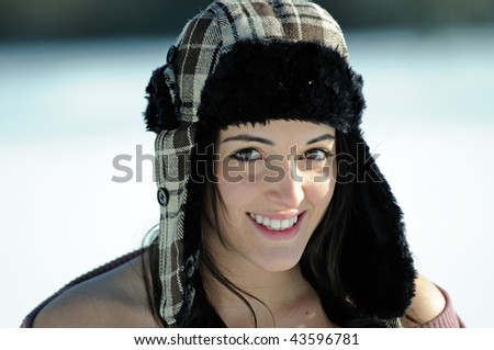 Young brunette woman in fur lined hat - stock photo