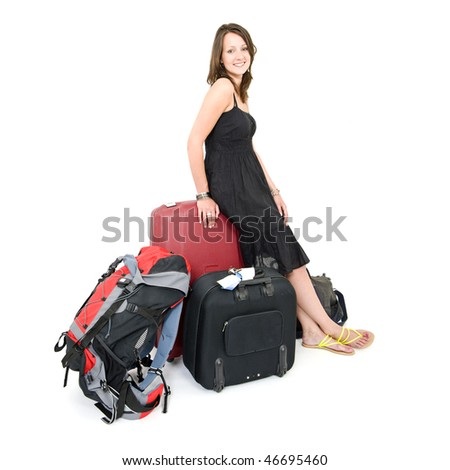 Young brunette woman, leaning on a suitcase, surrounded by more luggage