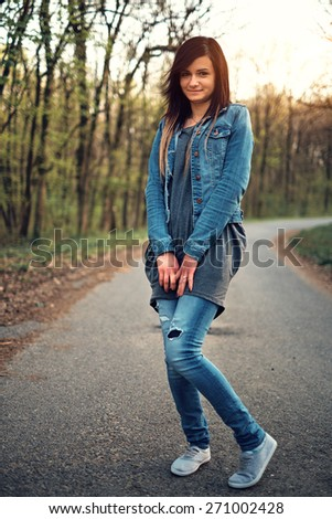 Young brunette woman on the forest road