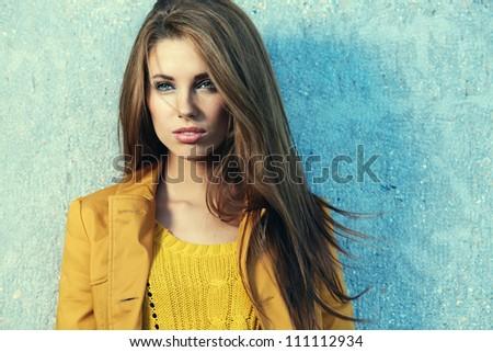young brunette woman portrait in autumn color - stock photo