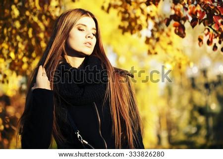 young brunette woman portrait in autumn color. colorful autumn portrait, street fashion. - stock photo