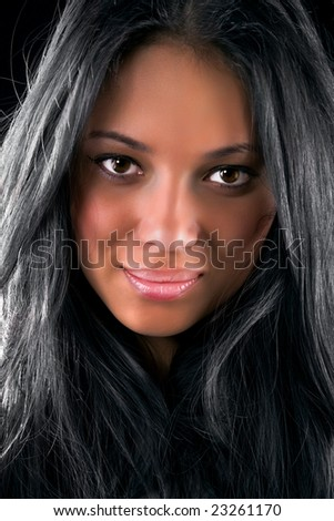 Young brunette woman portrait. On dark background. - stock photo