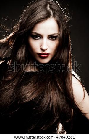 young brunette woman portrait, studio shot - stock photo