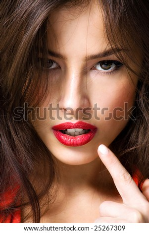 young brunette woman showing her lips