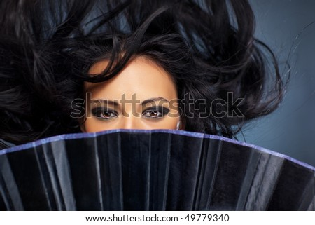 Young brunette woman stranger with fluttering hair. - stock photo