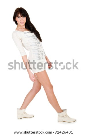 Young brunette woman wearing a white dress isolated on a white background