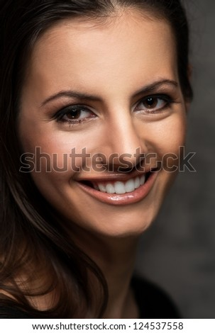 Young brunette woman with beautiful smile - stock photo