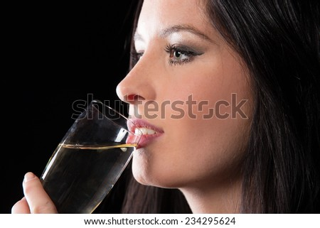 Young brunette woman with champagne glass, celebration theme. - stock photo
