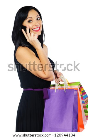 Young brunette woman with colorful shopping bags isolated on white - stock photo