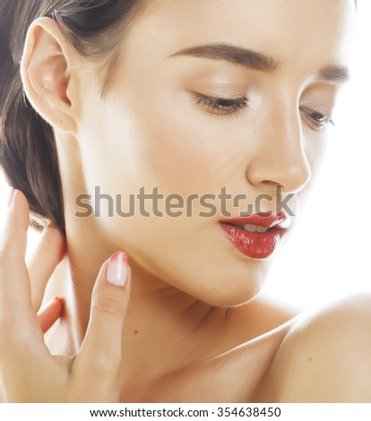 young brunette woman with hands on face isolated white background close up spa sensual red lips, makeup nude - stock photo