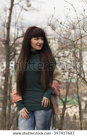 Young brunette woman with long hair at the park