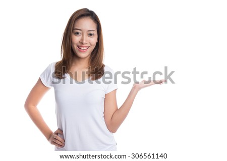 Young brunette woman with open hand palm, presenting something, on white background. - stock photo