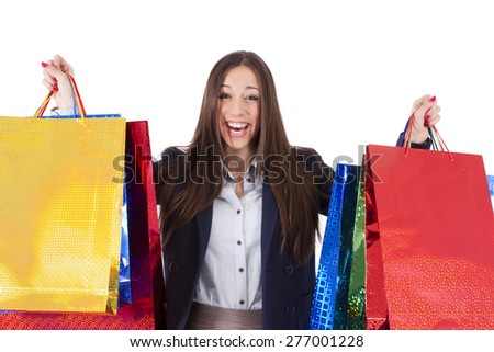 young brunette woman with shopping bags - stock photo