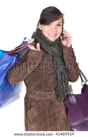 young brunette woman with shopping bags. over white background