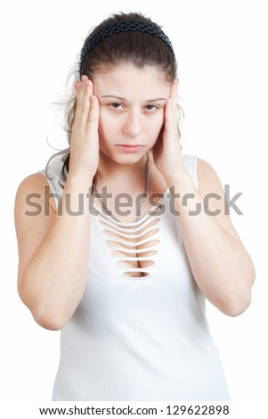 young brunette woman with splitting headache - isolated on white background - stock photo