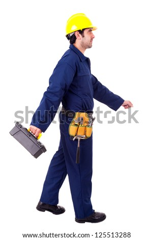 Young builder walking with a toolbox, isolated on white - stock photo