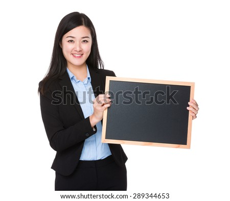Young buisnesswoman show with black board