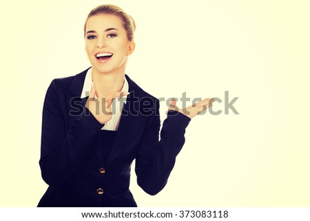 Young busiensswoman showing something  - stock photo