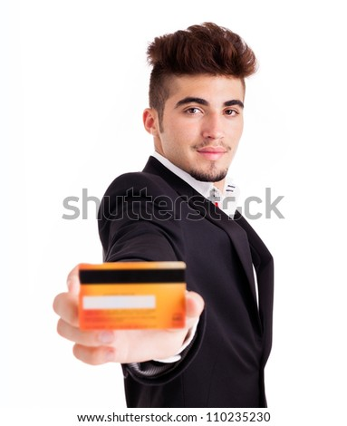 Young busineness man with credit card on white background - stock photo
