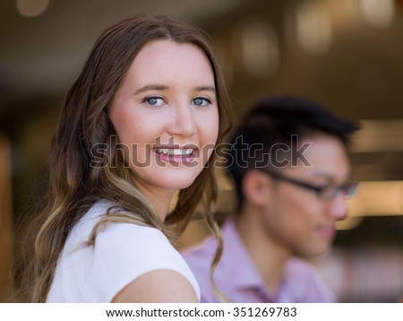 Young busines woman sitting and working in office