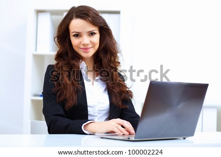 Young busines woman with notebook - stock photo