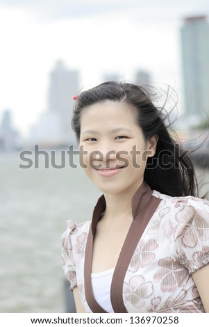 Young businese chinese women in the city background - stock photo