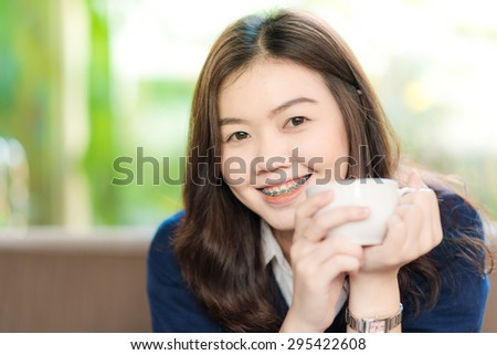 Young Business asian smiling woman Having a Coffee Break.