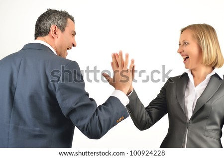 Young business colleagues giving each other a high five isolated on white background - stock photo